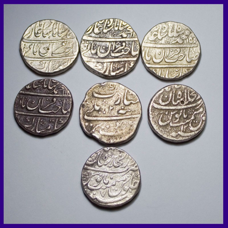 Lot of 7 Mughal One Rupee Silver Coins